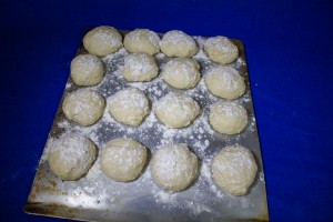 Arrange on a greased cookie sheet in a 4X4 array.Dust the top of the uncooked rolls with flour.